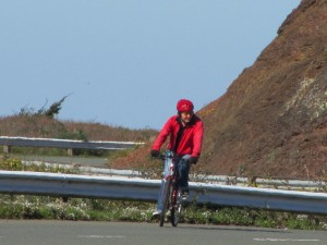 A cyclist near the pink barrio
